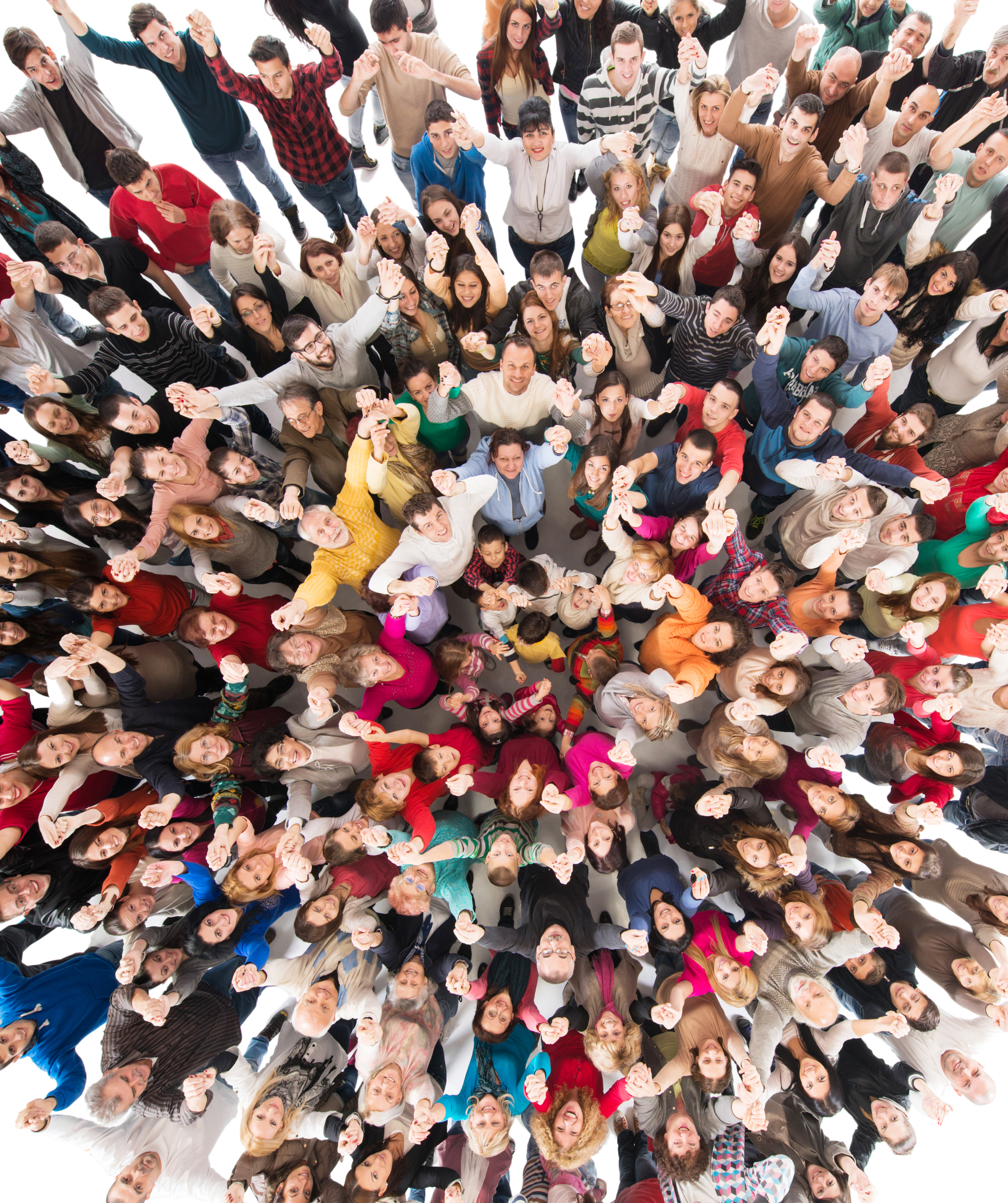 Directly above view of cheerful group of people with arms raised looking at camera.